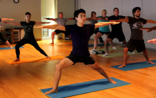 doing yoga at yoga studio